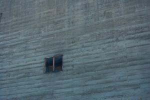 Window in grey brick wall
